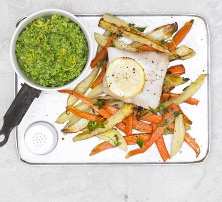 Oven-bake white fish with carrots and potatoes served with pea puree