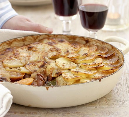 Lancashire hotpot in a wide shallow casserole dish