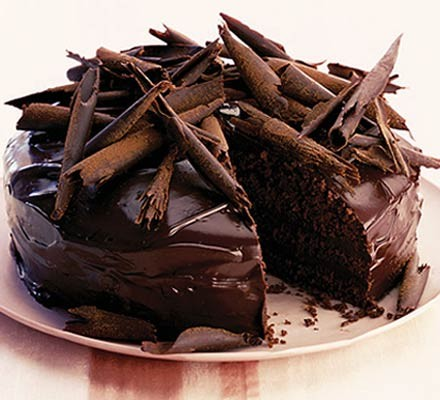 Ultimate chocolate cake topped with chocolate curls