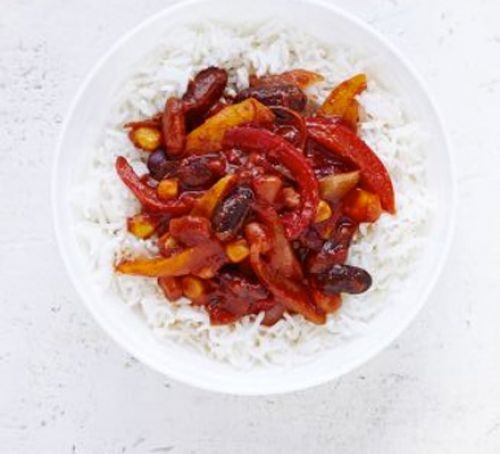 Bean and pepper chilli with rice in bowl