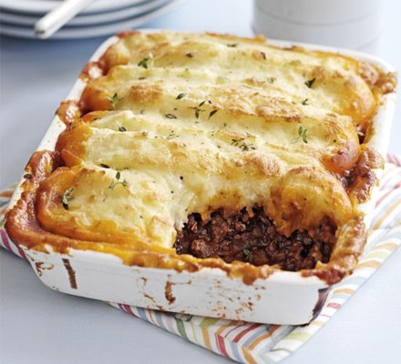 Cottage pie in a rectangular dish with portion taken out