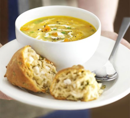 Roast chicken soup in a bowl with crusty bread