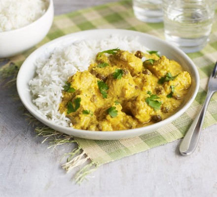 Plate of chicken korma with basmati rice