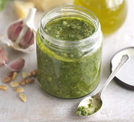 Classic pesto in a jar with a spoon