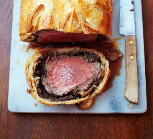 Beef Wellington sliced on board