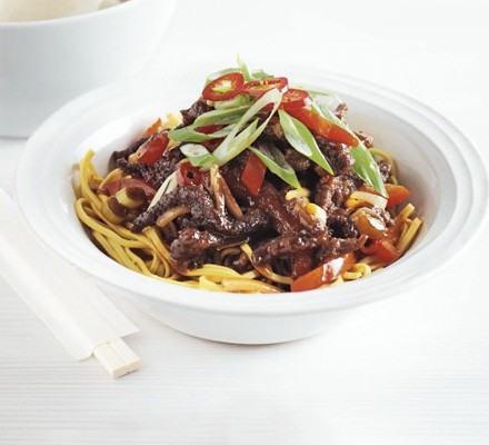 Crispy chilli beef in a bowl with chopsticks