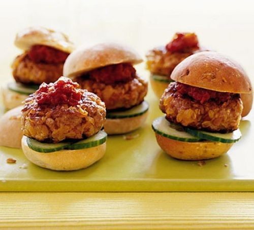 Turkey burgers with relish and cucumber on buns