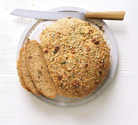 Sliced walnut seed loaf with knife