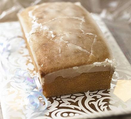 Lemon drizzle cake loaf on a pretty platter