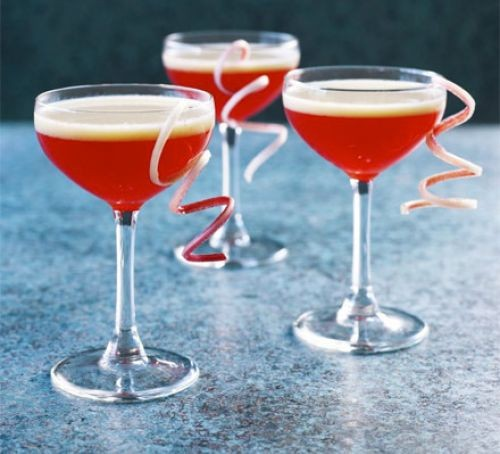 Three glasses of red rhubarb and custard cocktail
