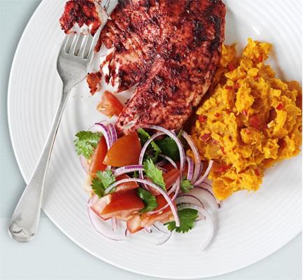 Tandoori tilapia with spicy sweet potato mash & tomato salad