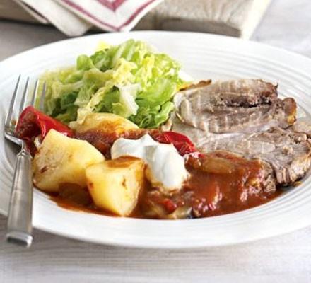 Pot-roast pork goulash with potatoes & greens