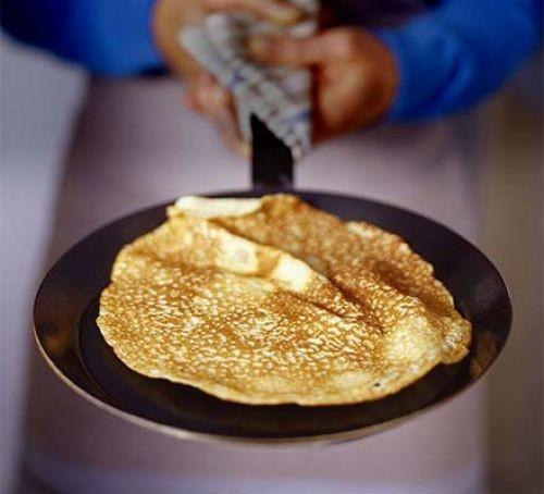 Pancake being made in a frying pan