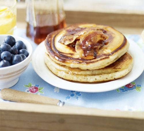 Pancakes on plate with syrup