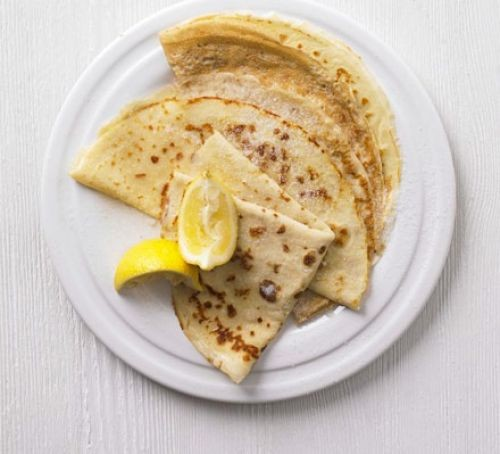 Crepes with lemon on plate