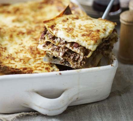 Lasagne in a dish with slice out