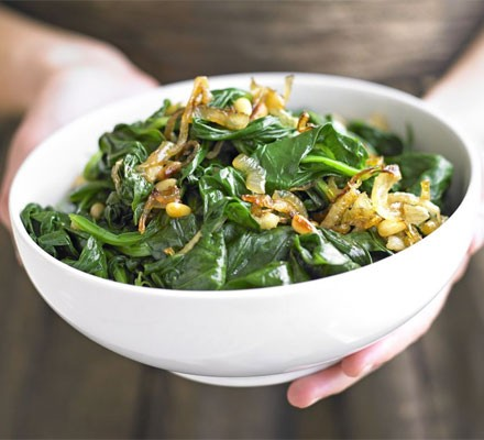 Spinach with onions & pine nuts