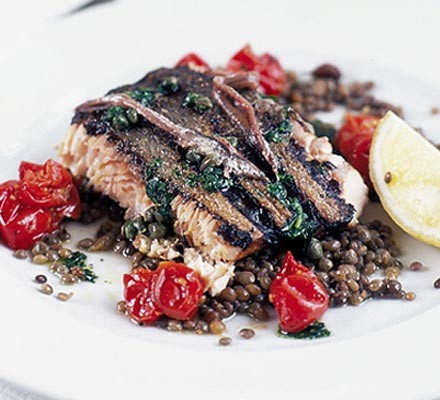 Grilled wild salmon with anchovies, capers & lentils