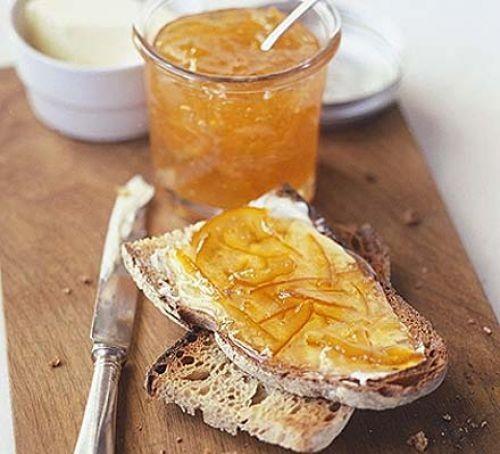 Pot of marmalade and marmalade on toast