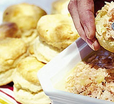 Buttermilk scones being spread with topping