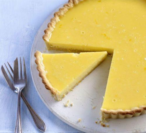 Lemon tart sliced on plate