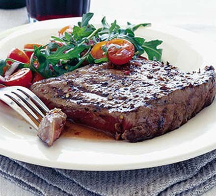 Coriander steaks with tomato & rocket salad