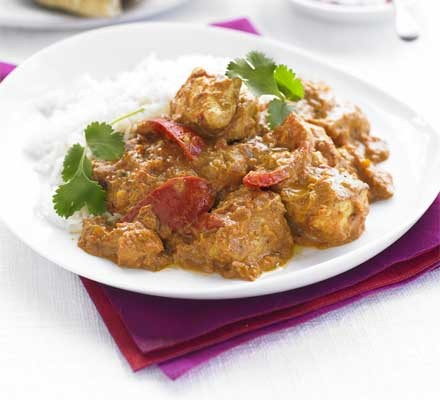Chicken tikka masala with rice on a plate