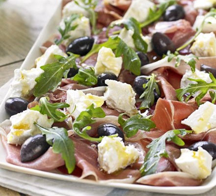 Serrano ham, olive, feta & rocket platter with homemade crostini