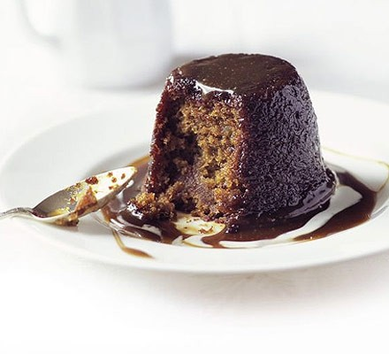 Sticky toffee pudding with spoon taken out