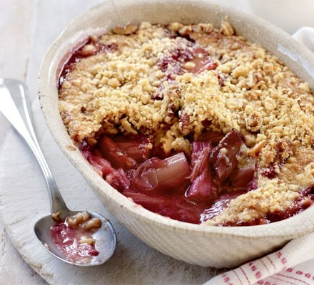 Rhubarb crumble with scoop taken out