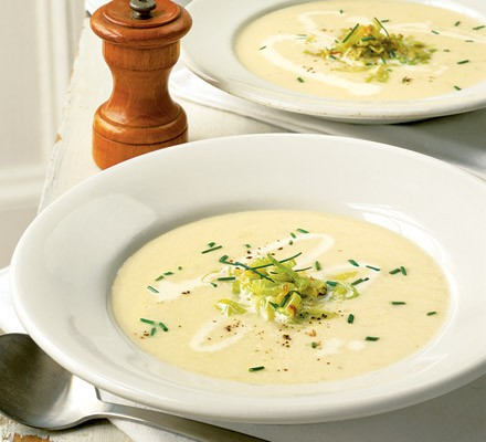 Leek & potato soup garnished with chives, buttered leeks & cream