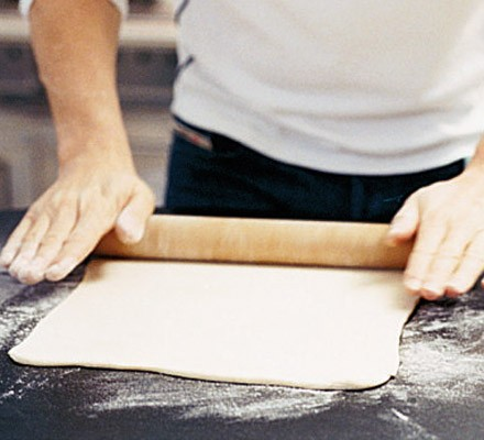 Rough-puff pastry being rolled on a surface