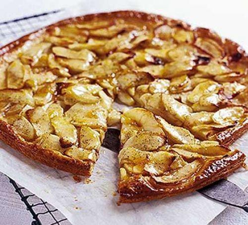 Apple tart with slice cut