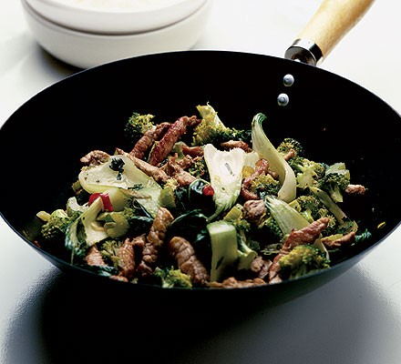 Spiced pork with heaps of stir-fried greens