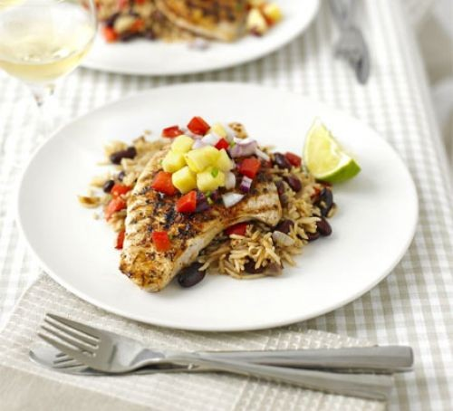 Cajun turkey steak on a bed of rice and topped with salsa