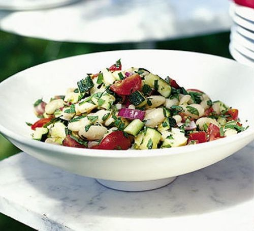 Butter bean and tomato salad in a white bowl