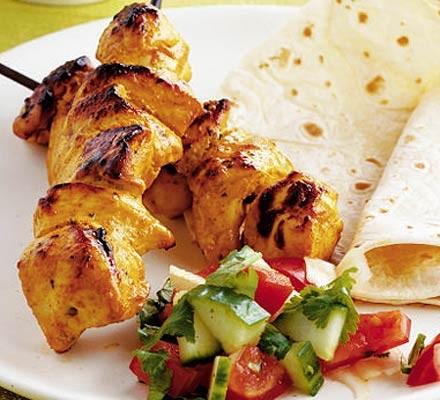 Chicken tikka kebabs with Indian salad