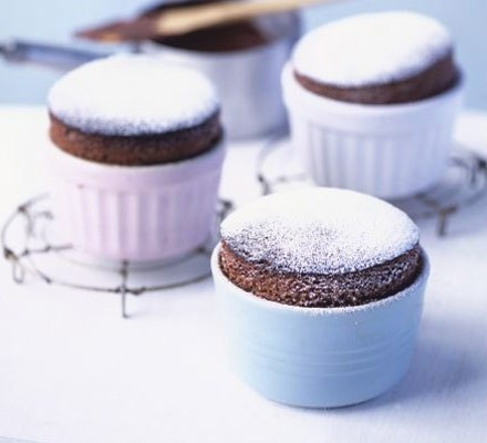 Hot chocolate soufflés with chocolate cream sauce