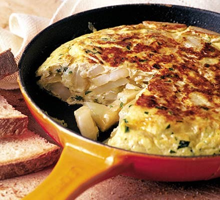 Spanish omelette in a cast iron frying pan