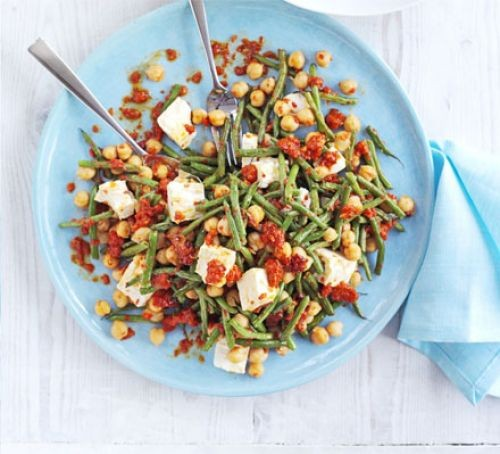 Feta and grain salad on plate with cutlery