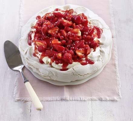 Strawberry Pavlova on a plate with cake slice