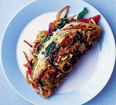 Omelette stuffed with stri-fried vegetables