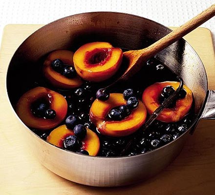 Caramel poached peaches with blueberries