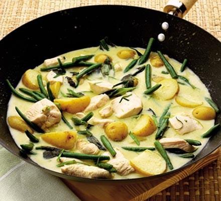 Thai green chicken curry in a wok