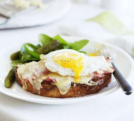 Croque madame with spinach salad