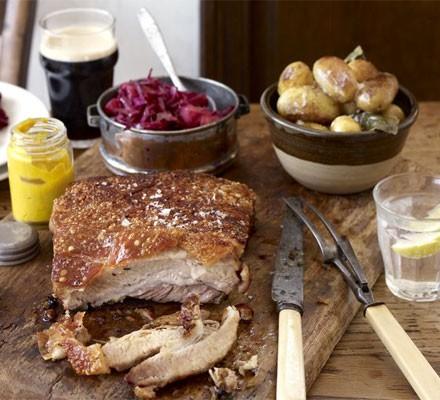 Three-hour pork belly on a chopping board