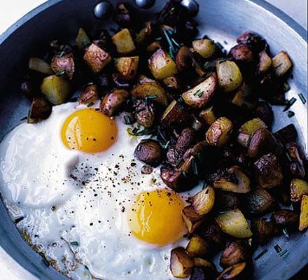 Fried eggs with rosemary sautéed potatoes