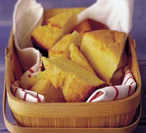 Thick wedges of cornbread in a basket