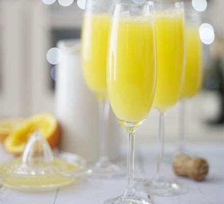 Mimosa cocktails in tall glasses