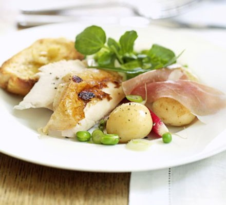 Herby roast chicken with garlic lemon toasts